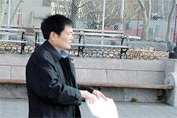 Mr. Guo Chuanjie, the Vice Secretary of the Chinese Communist Party Committee for the Chinese Academy of Sciences, pictured here being served with legal papers in New York City's Battery Park. The judgment, entered against him this week, was for claims of genocide, torture, and crimes against humanity.