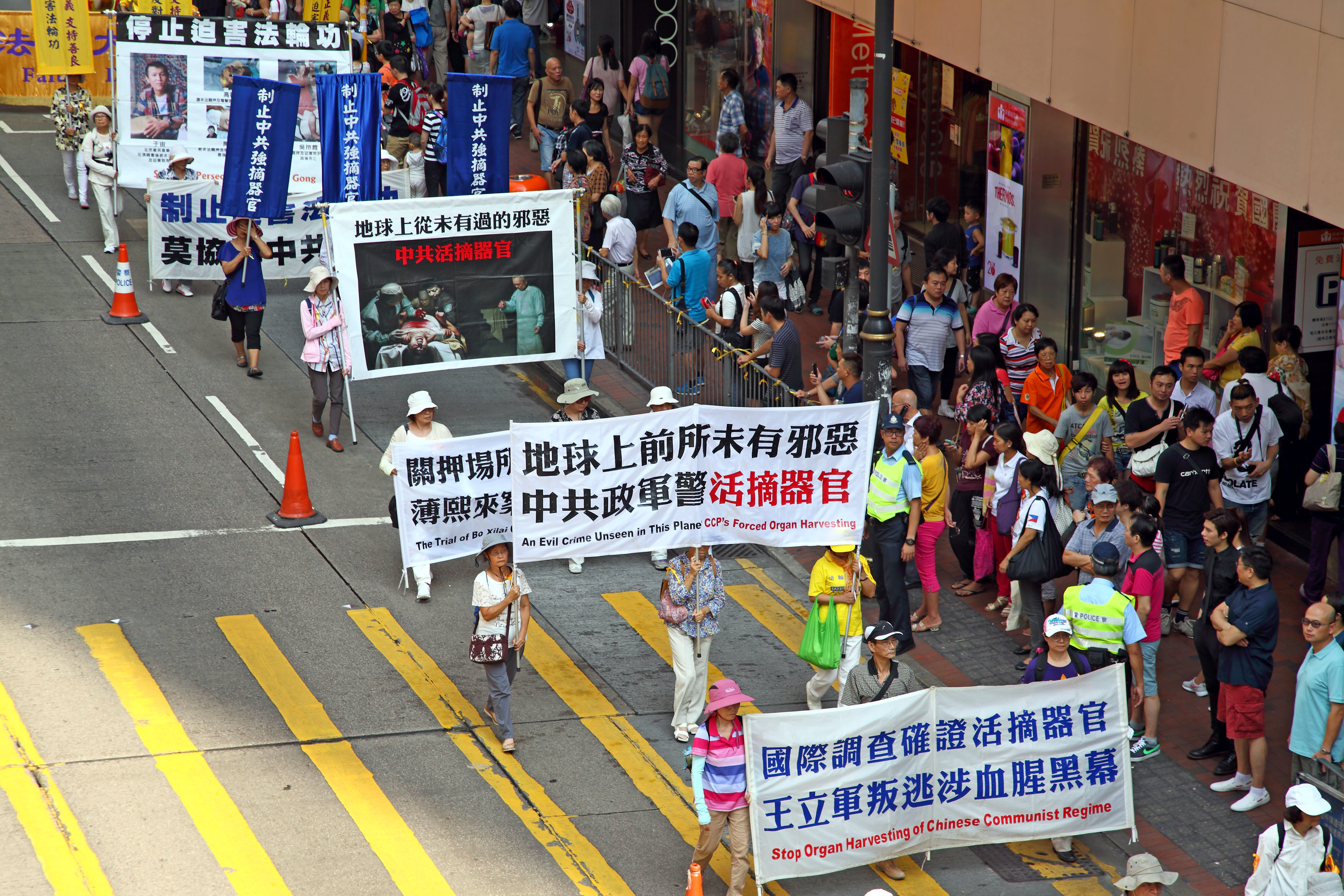 an analysis of the paper falun gong protest mars chinas national day Tensions culminated in april 1999, when over 10,000 falun gong practitioners gathered peacefully near the central government compound in beijing to request legal recognition and freedom from state interference.