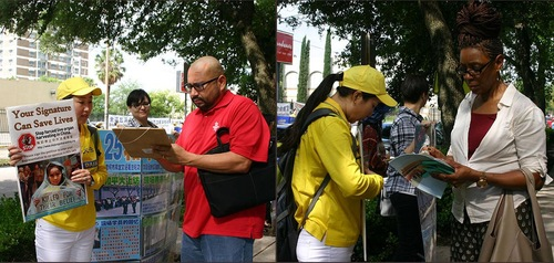 Para pejalan kaki menandatangani petisi untuk mendukung praktisi Falun Gong
