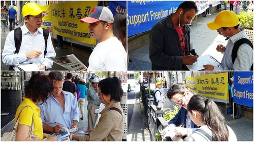 Para pejalan kaki menandatangani kartu pos untuk meminta perdana menteri Australia agar peduli terhadap penganiayaan Falun Gong selama kunjungannya ke Tiongkok