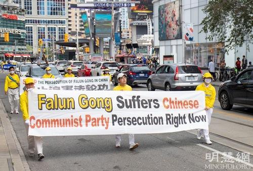 https://en.minghui.org/u/article_images/2021-8-23-toronto-falun-gong-parade_07_ududUsT.jpg