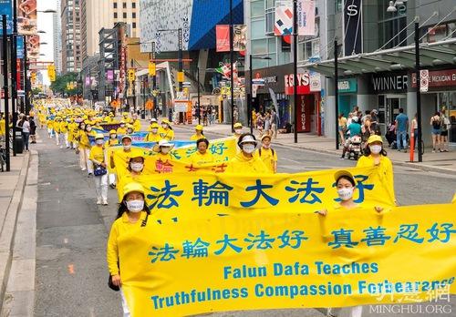 https://en.minghui.org/u/article_images/2021-8-23-toronto-falun-gong-parade_04_M1Bmjfy.jpg
